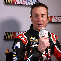 Driver Kurt Busch speaks with the media during the NASCAR Media Day event at Daytona International Speedway on Thursday, February 14, 2013 in Daytona Beach, Florida.  (AP Photo/Alex Menendez)