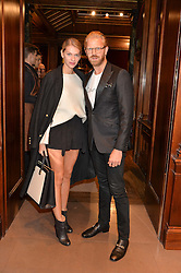 ALISTAIR GUY and BARBORA BEDIOVA at the opening of the exhibition 'My Mother Was A Reeler' at Etro, 43 Old Bond Street, London on 5th October 2016.