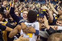 Jan 10, 2017; Morgantown, WV, USA; West Virginia Mountaineers guard Daxter Miles Jr. (4) celebrates with fans after beating the Baylor Bears at WVU Coliseum. Mandatory Credit: Ben Queen-USA TODAY Sports