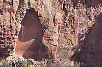 The white markings on the sandstone wall indicate that a  falcon, or another  bird of prey has built a nest on the canyon wall.  Colorado National Monument.  Colorado, USA.