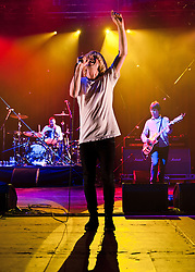 """© Licensed to London News Pictures. 08/06/2012. London, UK. The Charlatans perform live at Hammersmith Apollo, playing their 1997 and fifth studio album """"Telling' Stories"""" in its entirety.  In this photo - Jon Brookes, Tim Burgess, Mark Collins.  Photo credit : Richard Isaac/LNP"""