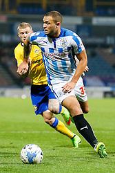Joel Lynch of Huddersfield is challenged by James McClean of Wigan - Photo mandatory by-line: Rogan Thomson/JMP - 07966 386802 - 16/09/2014 - SPORT - FOOTBALL - Huddersfield, England - The John Smith's Stadium - Huddersfield Town v Wigan Athletic - Sky Bet Championship.
