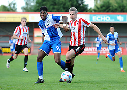 Arron Downes of Cheltenham Town is challenged by Ellis Harrison of Bristol Rovers - Mandatory by-line: Dougie Allward/JMP - 25/07/2015 - SPORT - FOOTBALL - Cheltenham Town,England - Whaddon Road - Cheltenham Town v Bristol Rovers - Pre-Season Friendly