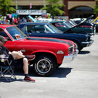 Thomas Wells | BUY at PHOTOS.DJOURNAL.COM<br /> Corey Henery of Walls Mississippi who has brought his '74 Chevy Nova to the Blue Suede Cruise for the last several years now waits for potential buyers to take it off his hands.