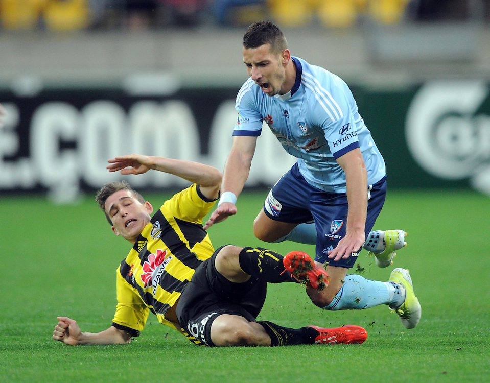 Phoenix's Lois Fenton, left tackles Sydney FC's Nikola Petkovic in the A-League football match at Westpac Stadium, Wellington, New Zealand, Sunday, April 26, 2015. Credit:SNPA / Ross Setford
