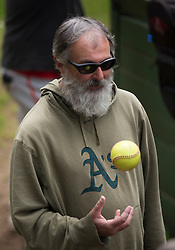 Legendary hurler Jay flips a ball as he awaits his turn on the mound, as the Montclair softball league celebrates its 50th season, Saturday, April 22, 2017, at Montclair Park in Oakland, Calif. The pickup softball game, played every Saturday by a group of enthusiasts ranging in age from 20 to 75, started in 1968 in Berkeley and moved to Montclair about 25 years ago. (Photo by D. Ross Cameron)