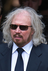 © London News Pictures. 08/06/2012. Thame, UK.  Barry Gibb, brother of Robin Gibb leaving the home of former Bee Gee Robin Gibb on his way to St Mary's Church in Thame, Oxfordshire for the funeral of Robin Gibb on June 8, 2012. Robin Gibb died on May 20, 2012 aged 62 following a long battle against cancer. Photo credit: Ben Cawthra/LNP