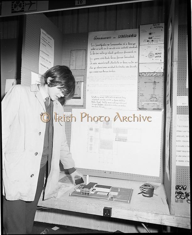 1972.07/01/1972.01/07/1972.7th January 1972.The Aer lingus Young Scientist Exhibition at the RDS, Dublin..Piaras O'Ceallaigh from Colaiste Mhuire, Cearnog Pharnell, Dublin with his exhibition 'Tionscnamh ag leiriu conas cumhacht adamhach a chur ag feidhmiu mar ghinteoir leictreachais in Eirinn agus a bhuntaisti a leiriu.'..