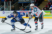 KELOWNA, CANADA -FEBRUARY 8: Kris Schmidli #16 of the Kelowna Rockets stick checks Taylor Crunk #22 of the Victoria Royals on February 8, 2014 at Prospera Place in Kelowna, British Columbia, Canada.   (Photo by Marissa Baecker/Getty Images)  *** Local Caption *** Kris Schmidli; Taylor Crunk;
