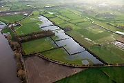 Nederland, Limburg, gemeente Boxmeer, 15-11-2010. Maasheggen in de Oeffelter Meent (=gemeenschappelijke weidegrond). Percelen gescheiden door gevlochten heggen van meidoorn en sleedoorn gelegen in de uiterwaarden van de Maas en in gebruik voor het weiden van vee. Historisch landschap met bijzondere ecologische waarde Maasheggen near Boxmeer en Oeffelt. Plots (for cattle) are seprated by means of twinned or woven hedges of hawthorn and blackthorn. The hedges are located in the floodplain of the Meuse and used for grazing cattle. Historic landscapes with special ecological value..luchtfoto (toeslag), aerial photo (additional fee required).foto/photo Siebe Swart