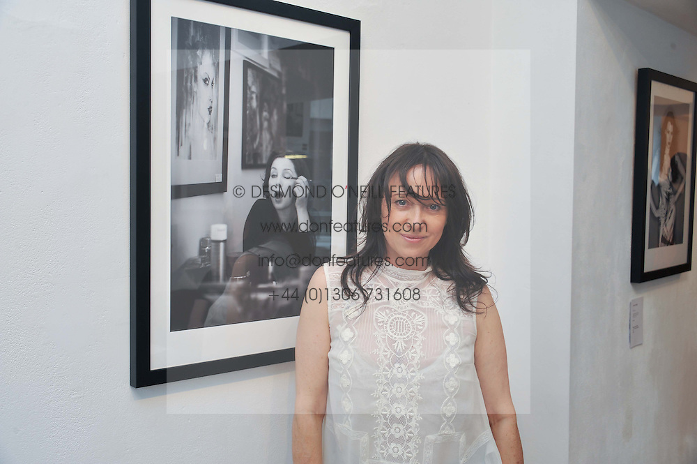 Photographer DEBBI CLARK at a private view of her portrait photographs in support of the Sir Hubert von Herkomer Arts Foundation, held at The Strand Gallery, 32 John Adam Street, London WC2Non 8th May 2013.
