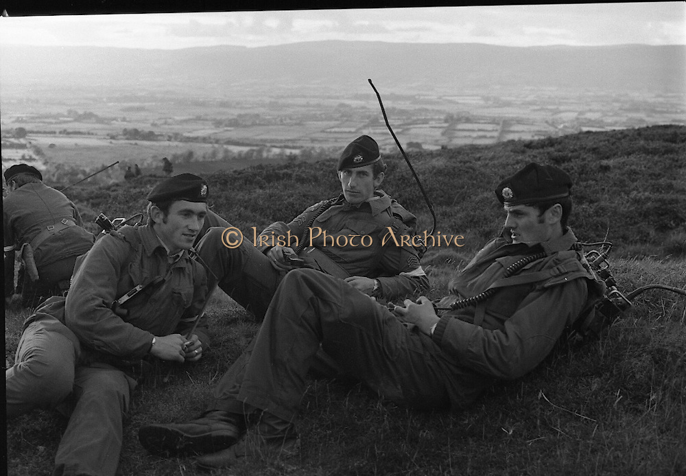 "Army Exercises In Co Sligo.   (L37).<br /> 1977.<br /> 05.09.1977.<br /> 09.05.1977.<br /> 5th September 1977.<br /> The Army Reserve Brigade, which is made up of regular units from the Southern Command, are conducting a series of conventional military exercises in counties Mayo and Sligo from the 5th to the 9th September. Approximately 1,500 men and 250 vehicles are involved. The exercise was codenamed ""Humbert"" after an ill fated expedition by French troops into Ireland on 23rd August 1798. 1,100 French troops with Irish support took on the incumbent English forces. After some initial success they were defeated at Ballinamuk on 8th Sept 1798 by the army of Cornwallis.<br /> <br /> The signals team take a break for some rest and recuperation during the exercises."