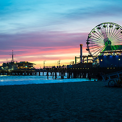 Santa Monica Pier photo at sunset at Santa Monica Beach. Santa Monica Pier is along the Pacific Ocean in Southern California in he United States. Copyright ⓒ 2017 Paul Velgos with All Rights Reserved.