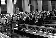 State Funeral Of Mrs Thomas Clarke..1972..08.10.1972..10.08.1972..8th October 1972..Today the state funeral of Mrs Kathleen Clarke took place at the Pro Cathedral,Dublin. Mrs Clarke was the wife of the late Thomas Clarke who was executed in Kilmainham Jail in 1916. Thomas Clarke was a signatory of the Irish Proclamation of 1916...Image of the congregation as they proceed to the altar for communion. In the far background is Garret Fitzgerald TD.