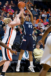 Rhode Island forward Sierra Cooper (30) shoots over Virginia forward/center Abby Robertson (30).  The Virginia Cavaliers women's basketball team defeated the Rhode Island Rams 89-53 at the John Paul Jones Arena in Charlottesville, VA on January 9, 2008.