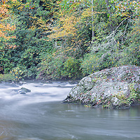 Fall foliage brightens the landscape of the Cullasaja River, in the Nantahala National Forest, in North Carolina.