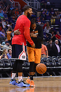 Apr 1, 2016; Phoenix, AZ, USA; Washington Wizards forward Markieff Morris (L) shares a laugh with Phoenix Suns guard Archie Goodwin (20) at Talking Stick Resort Arena. The Washington Wizards won 106- 99. Mandatory Credit: Jennifer Stewart-USA TODAY Sports