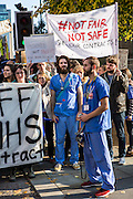 Two bearded Junior doctors and other NHS staff demonstrate at the TUC No to Austerity demo outside the Conservative party conference, Manchester. 4th October 2015