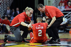 22 February 2017:  John Munn and his assistant check out DJ Clayton(2) for an injury during a College MVC (Missouri Valley conference) mens basketball game between the Southern Illinois Salukis and Illinois State Redbirds in  Redbird Arena, Normal IL