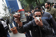A protester displays a teargas canester shoot by the police during a  demonstration in the center of Tunis. People still protest against the partecipation of the Constitutional Democratic Rally, RCD, party of Ben Ali, to the national unity government that today january 18 lost three ministers of the opposition.