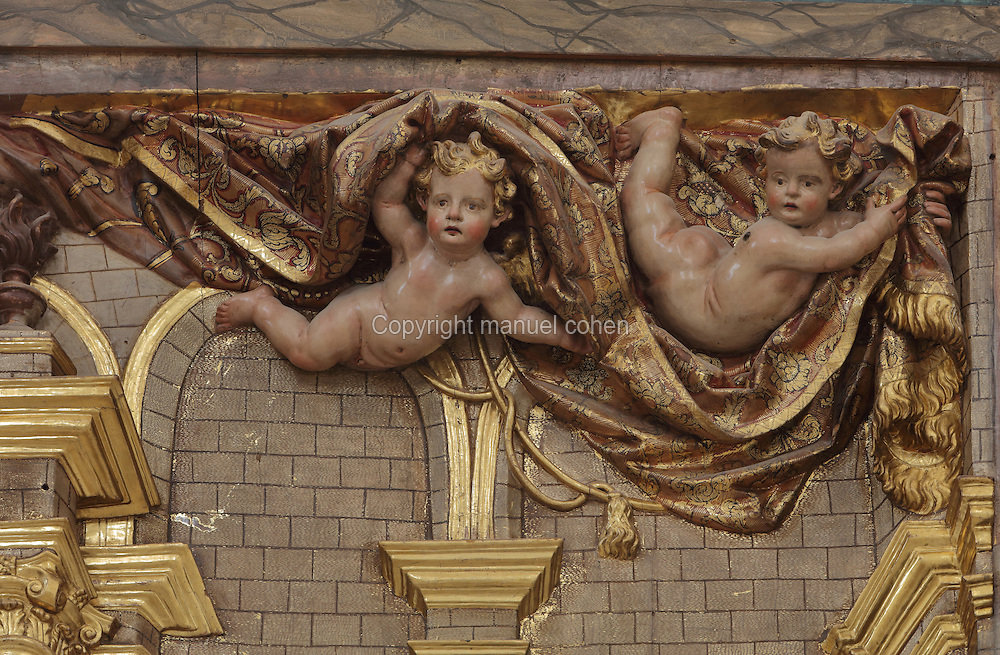 Sculptural detail of cherubs holding back curtains, detail from the altarpiece, 1731, by Cristofor Cros, commissioned by canon Pere Vidal, in the Capella de San Pere, in the Cathedral of St Mary, designed by Benito Dalguayre in Catalan Gothic style and begun 1347 on the site of a Romanesque cathedral, consecrated 1447 and completed in 1757, Tortosa, Catalonia, Spain. The cathedral has 3 naves with chapels between the buttresses and an ambulatory with radial chapels. Picture by Manuel Cohen