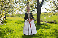Marina, member of the Altl&auml;nder Trachtengruppe von 1970 e. V., is wearing a traditional bridal gown in Jork, Germany on April 30, 2017.<br /> <br /> This traditional costume and the jewelry is original and from around the 1900s. The bridal gown is a replica. Until the wedding, girls and young women used to wear only black. They always covered her hair and it is said that most of the time the man found out the color of his wife's hair after the wedding.<br /> <br /> This is part of the series about Traditional Gowns from different regions of Germany, worn by young members of local dance groups and cultural associations that exist to preserve and celebrate the cultural heritage. The portraiture series is a depiction of an old era with different social values and religious beliefs in an antiquated civil society with very few of those dresses left.
