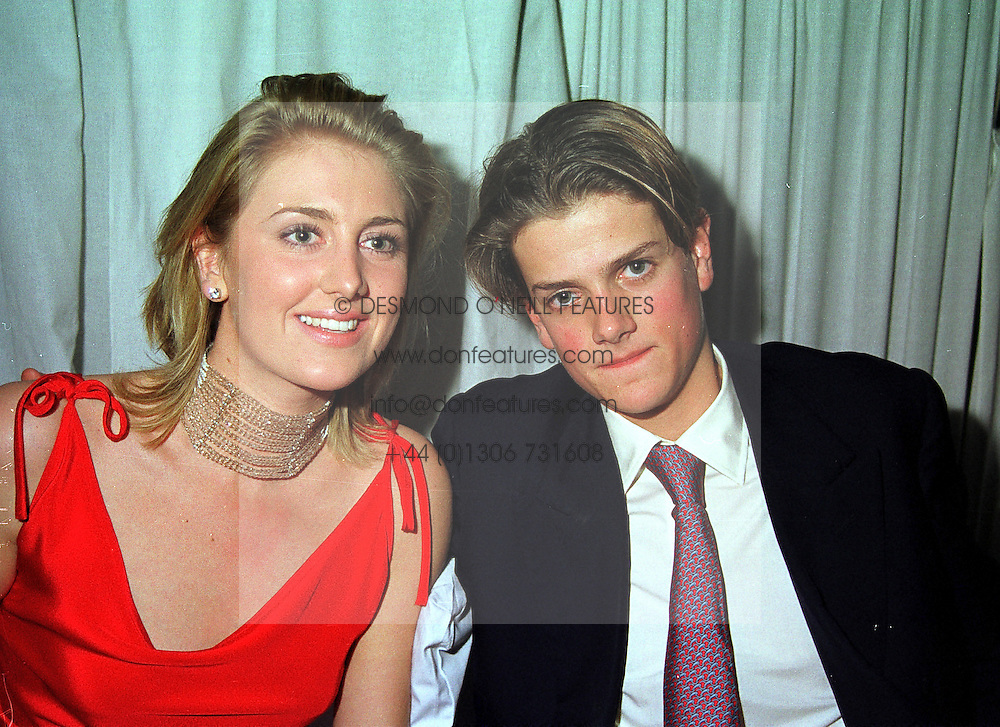 LADY EMILY COMPTON and the HON.ALEX SPENCER-CHURCHILL son of Lord Charles Spencer-Churchill, at a party in London on 8th November 1999.MYT 61