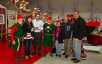 """Mayor"" Renee McVey receives the key to Christmas Village from Laconia Mayor Ed Engler and city officials during opening night of Christmas Village at the Laconia Community Center.  (l-r) Tinsel (Ernie Bolduc), Renee McVey, Mayor Ed Engler, Twinkle (Armand Bolduc), Ava Doyle, Bob Hamel and Scott Myers)  (Karen Bobotas/for the Laconia Daily Sun)"