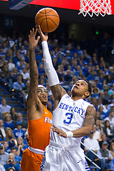 Kentucky guard Tyler Ulis, right, drives to the basket with pressure from in the first half.<br /> <br /> The University of Kentucky hosted the University of Florida, Saturday, Feb. 06, 2016 at Rupp Arena in Lexington .