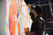 LAS VEGAS, NV - JULY 9:  An artist paints a mural during the UFC Fan Expo at the Las Vegas Convention Center on July 9, 2016 in Las Vegas, Nevada. (Photo by Cooper Neill/Zuffa LLC/Zuffa LLC via Getty Images) *** Local Caption ***