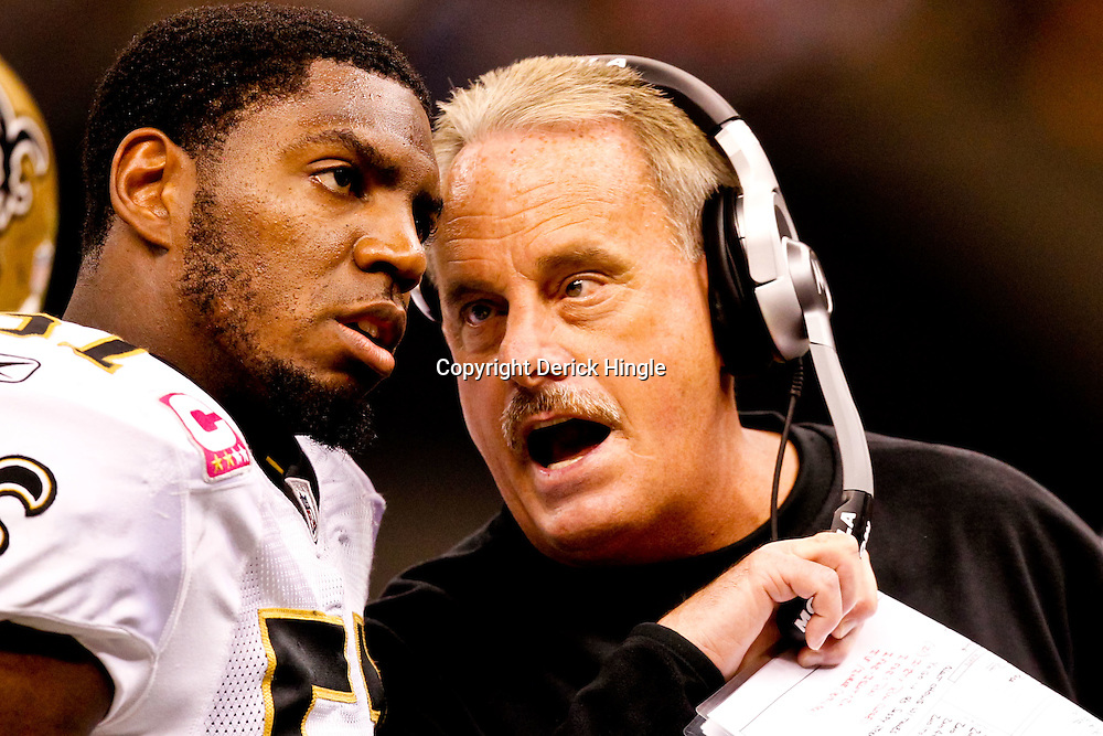 Oct 24, 2010; New Orleans, LA, USA; New Orleans Saints assistant head coach/linebackers coach Joe Vitt talks with New Orleans Saints linebacker Jonathan Vilma (51) during the first half of a game against the Cleveland Browns at the Louisiana Superdome. Mandatory Credit: Derick E. Hingle