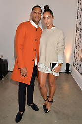 REGGIE YATES and TIA WARD at the launch of The Lulu Perspective to celebrate 25 years of Lulu Guinness held at 74a Newman Street, London on 13th September 2014.