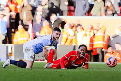 Liverpool's Cameron Brannagan brings down Liverpool's Raheem Sterling but no free kick is given  - Photo mandatory by-line: Matt McNulty/JMP - Mobile: 07966 386802 - 08/03/2015 - SPORT - Football - Liverpool - Anfield Stadium - Liverpool v Blackburn Rovers - FA Cup