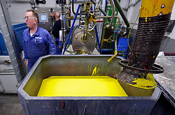 AkzoNobel employees work in the paint production facility in Sassenheim, the Netherlands, Wednesday, Dec. 22, 2010. Akzo Nobel NV, the world's biggest paint maker, reported a 21 percent increase in third quarter net income to 238 million euros. (Photo © Jock Fistick)