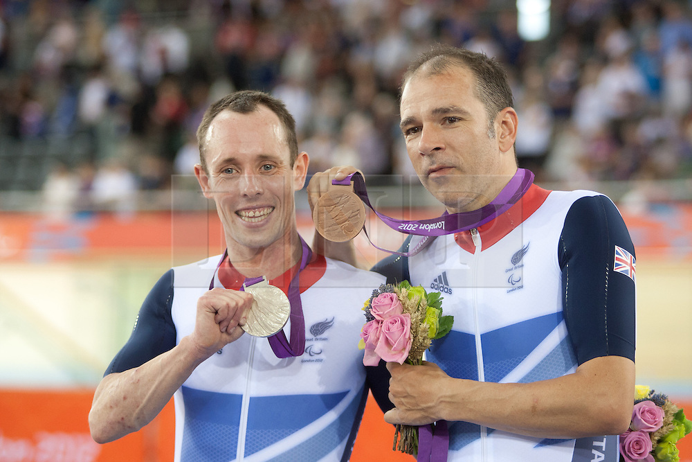 © London News Pictures. 31/08/2012. Stratford, London, UK. L to R Shaun McKeown GBR and Darren Kenny GBR- men's individual C3 pursuit silver and bronze medal winners. Photo credit should read Manu Palomeque/LNP