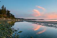 The sunrise at Cordova Bay is reflected in the tidal sandbar.