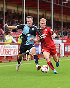 Crawley's man of the match Christian Scales defending under pressure from Garry Thompson during the Sky Bet League 2 match between Crawley Town and Wycombe Wanderers at the Checkatrade.com Stadium, Crawley, England on 29 August 2015. Photo by David Charbit.