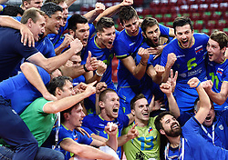 Players of Slovenia celebrate after Slovenia won 3-2 during volleyball match between National teams of Poland and Slovenia in Quarterfinals of 2015 CEV Volleyball European Championship - Men, on October 14, 2015 in Arena Armeec, Sofia, Bulgaria. Photo by Ronald Hoogendoorn / Sportida