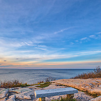 New England photography of a stone bench with a scenic ocean view at sunset in Rockport, Massachusetts on Cape Ann.<br /> <br /> New England photography image artwork of bench with a scenic ocean view is available as museum quality photography prints, canvas prints, acrylic prints, wood prints or metal prints. Prints may be framed and matted to the individual liking and decorating needs: <br /> <br /> https://juergen-roth.pixels.com/featured/bench-with-a-scenic-ocean-view-juergen-roth.html<br /> <br /> Good light and happy photo making!<br /> <br /> My best,<br /> <br /> Juergen
