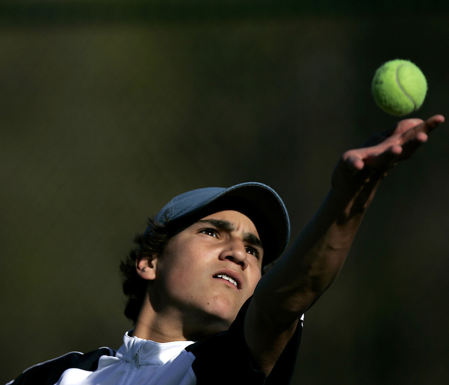 Scarsdale, NY / 2009 - Byram Hills' Kyle Berman serves the ball during a varsity boys tennis match between Byram Hills and Scarsdale at Scarsdale High School.  ( Mike Roy / The Journal News )