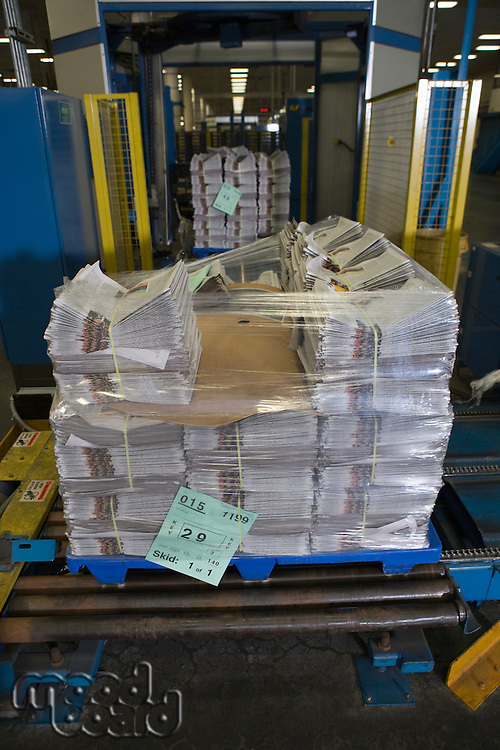 Pile of newspapers in factory