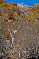 Ticino, Southern Switzerland. A waterfall tumbling down a steep mountainside, in Valle Onsernone.
