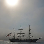 CASCO BAY, Maine- 8/4/17 --  The 295-foot U.S. Coast Barque Eagle sailed into Portland Harbor on Friday morning in scattered clouds.  They opened for tours Saturday and Sunday.<br /> &quot;We are thrilled with the chance to host the crew and cadets of 'America's Tall ship,'&quot; said Capt. Michael Baroody, commander of Coast Guard Sector Northern New England. &quot;Portland has a strong maritime heritage.&quot;<br /> Commanded by Capt. Matthew Meilstrup, the officers and permanent crew of Eagle train in seafaring using basics of wind power and traditional navigation.<br /> Cadets sail on Eagle for one to eight weeks, along with their instructors. Eagle recently toured Canada to celebrate the country's 150th anniversary. They sailed for New York City on Monday. Photo by Roger S. Duncan for the Forecaster