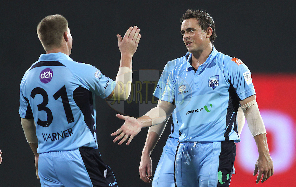 David Warner of NSW Blues and Stephen O'Keefe of NSW Blues celebrate a wicket during match 18 of the NOKIA Champions League T20 ( CLT20 )between the Chennai Superkings  and The NSW Blues held at the M. A. Chidambaram Stadium in Chennai , Tamil Nadu, India on the 4th October 2011..Photo by Shaun Roy/BCCI/SPORTZPICS