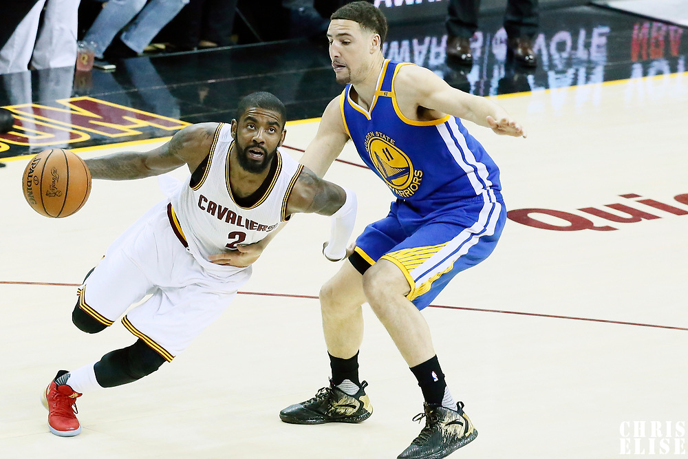 09 June 2017: Cleveland Cavaliers guard Kyrie Irving (2) drives past Golden State Warriors guard Klay Thompson (11) during the Cleveland Cavaliers 137-11 victory over the Golden State Warriors, in game 4 of the 2017 NBA Finals, at  the Quicken Loans Arena, Cleveland, Ohio, USA.