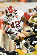January 7, 2013: Alabama running back Eddie Lacy (42) during 1st half of the Discover BCS National Championship game between the Alabama Crimson Tide and the Notre Dame Fighting Irish at Sun Life Stadium in Miami Gardens, Fl