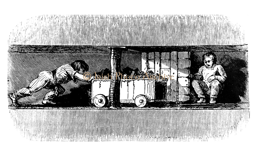Boy pushing a truck loaded with coal from the coal face to the bottom of the pit shaft. On right of the picture squats a smaller boy, the 'trapper', whose task it was to open and close the trap door for the trucks.   This was the first job a boy was given.  Britain, c1848.