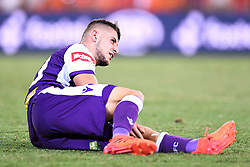 January 18, 2018 - Brisbane, QUEENSLAND, AUSTRALIA - Jake Brimmer of the Glory (#20) lies in the field injured during the round seventeen Hyundai A-League match between the Brisbane Roar and the Perth Glory at Suncorp Stadium on January 18, 2018 in Brisbane, Australia. (Credit Image: © Albert Perez via ZUMA Wire)