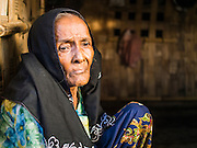 05 NOVEMBER 2014 - SITTWE, RAKHINE, MYANMAR: MOREYAM,  65, a Rohingya Muslim women, in the doorway of her room in a Rohingya IDP camp near Sittwe. After sectarian violence devastated Rohingya communities and left hundreds of Rohingya dead in 2012, the government of Myanmar forced more than 140,000 Rohingya Muslims who used to live in and around Sittwe, Myanmar, into squalid Internal Displaced Persons camps. The government says the Rohingya are not Burmese citizens, that they are illegal immigrants from Bangladesh. The Bangladesh government says the Rohingya are Burmese and the Rohingya insist that they have lived in Burma for generations. The camps are about 20 minutes from Sittwe but the Rohingya who live in the camps are not allowed to leave without government permission. They are not allowed to work outside the camps, they are not allowed to go to Sittwe to use the hospital, go to school or do business. The camps have no electricity. Water is delivered through community wells. There are small schools funded by NOGs in the camps and a few private clinics but medical care is costly and not reliable.    PHOTO BY JACK KURTZ