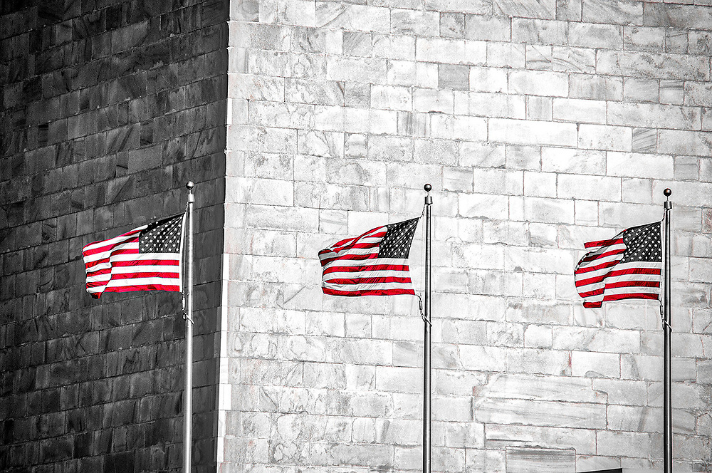 Three of the fifty flags that surround the Washington Monument on the National Mall of Washington, D.C.